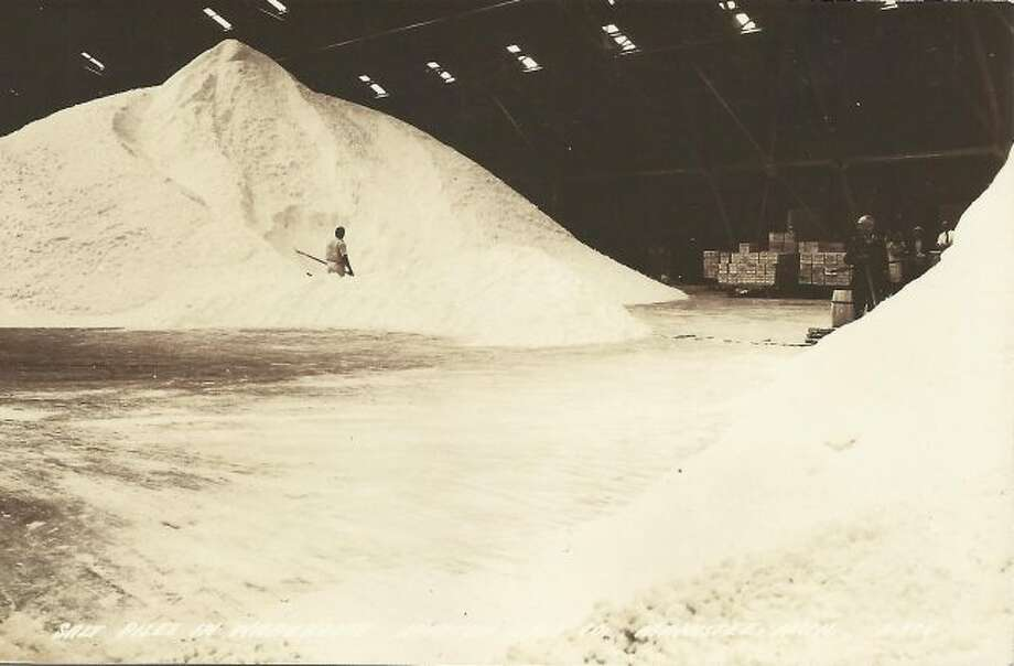 Salt rises to the ceiling inside one of the warehouses of the local salt plants in this picture from the 1940s.