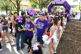 Participants in the 2019 Walk to End Alzheimer's take the lead as the group makes their way around TAMIU on Saturday.