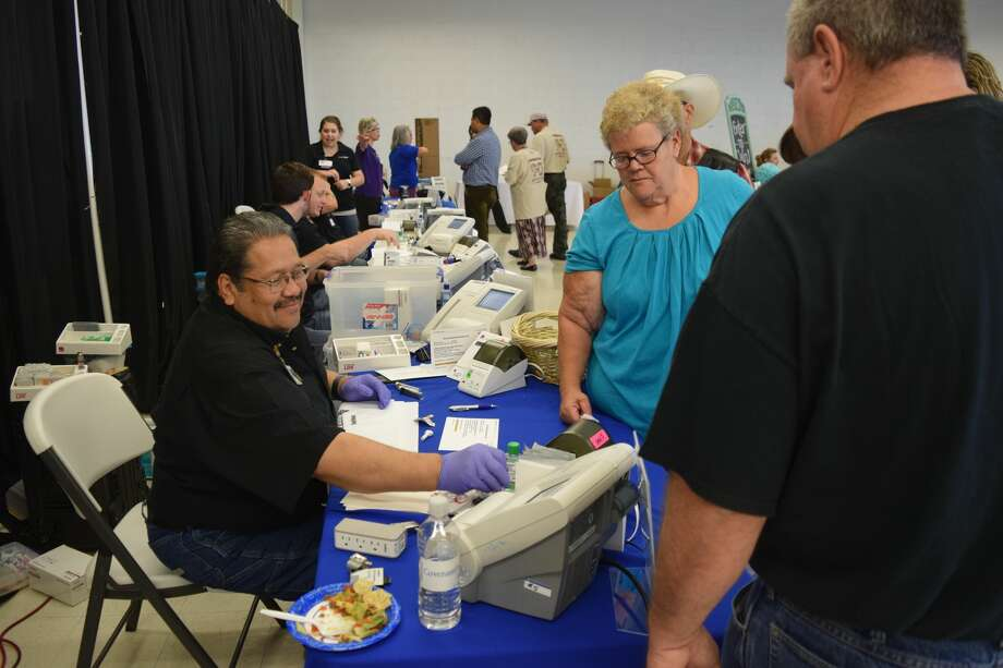 Guests browse the health fair during the 2018 event. Photo: Courtesy Photo/Covenant Health Plainview