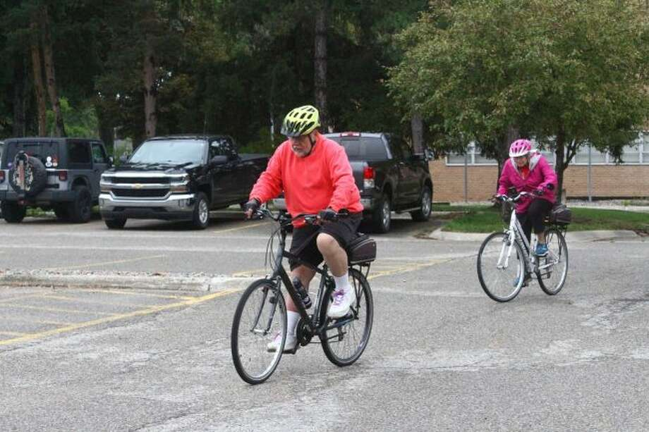 Participants of the fourth annual Bulldog Bike Tour prepare to take off on their day of riding from the Ferris State University Granger Center in Big Rapids. (Pioneer photo/Taylor Fussman)