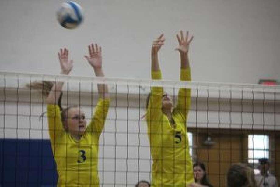 Morley Stanwood's Jaidyn Schmitt (5) and Madison Garbow (3) go for the ball.