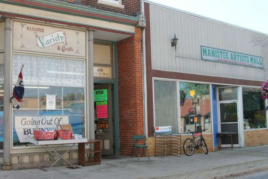 Manistee Variety store (left) is set to close at the end of November, and the Manistee Art Institute plans to move its operations into the former Manistee Artist's Mall in October after a recent purchase. Both buildings were owned by John Smith. (Michelle Graves/News Advocate)