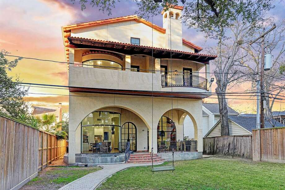 Located at 2431 Nottingham Street in Houston's Museum District, this oddball home was custom-made in 2013 and is on the market for $2.45 million. The home's over-the-top features include a tile roof imported from Portugal, master terrace that extends the entire width of the home, massive vaulted ceilings and designer stone floors. At 5,751 square feet, the home boasts five bedrooms and four full and three half bathooms, rec-area, mud room, game room, casita and study. Photo: Houston Association Of Realtors
