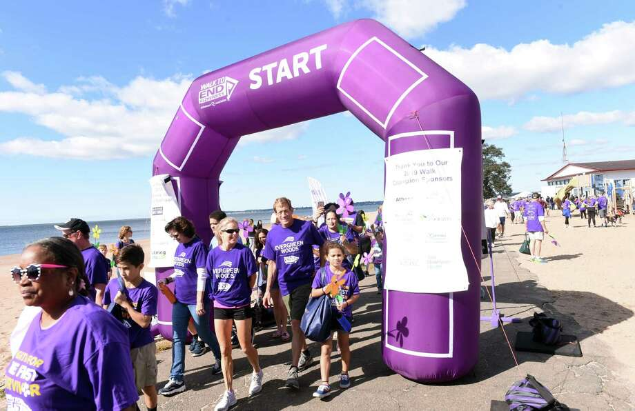 Walkers participate in the two-mile 2019 Walk to End Alzheimer's sponsored by the Alzheimer's Association of Connecticut at Lighthouse Point Park in New Haven on September 29, 2019. Photo: Arnold Gold / Hearst Connecticut Media / New Haven Register