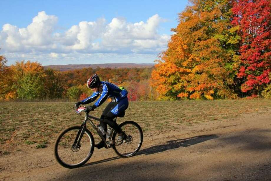 Riding a bike along one of the area's plentiful trails is a good way to see fall's brilliant colors. (File Photo)