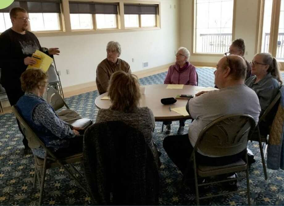 David Holmer (left), a former ISE exchange student, teaches German to Manistee seniors earlier this year. He will host a series of free classes on German music appreciation which are open to the public. (Courtesy Photo)