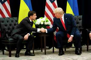 President Donald Trump meets with Ukrainian President Volodymyr Zelenskiy in September. A phone call between the two has spearheaded an impeachment inquiry. But the president's critics are confusing that with the official inquiry by a U.S. attorney into the counterintelligence investigation directed at Trump's 2016 campaign.