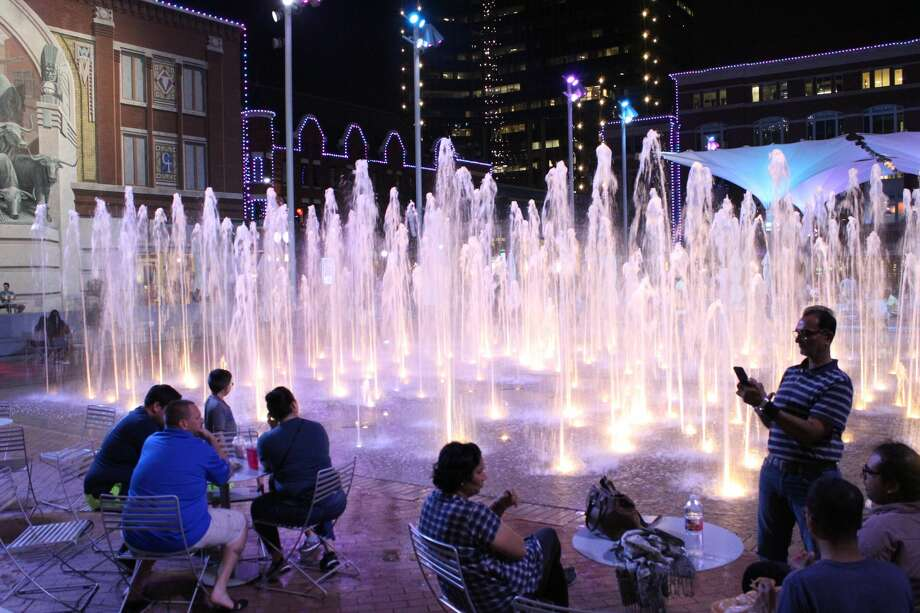 Crowds gather in the evening at the fountains at Sundance Square. Photo: Rich Lopez/ Midland Magazine