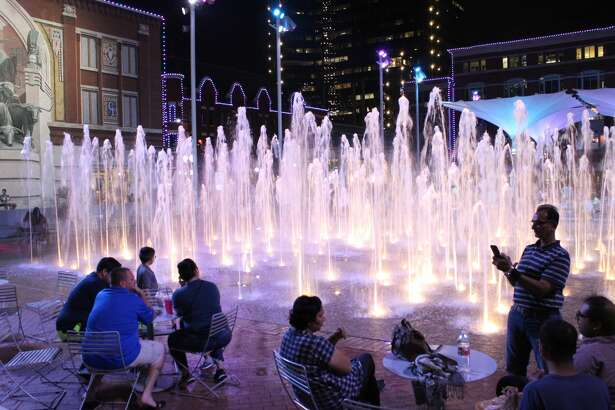 Crowds gather in the evening at the fountains at Sundance Square.