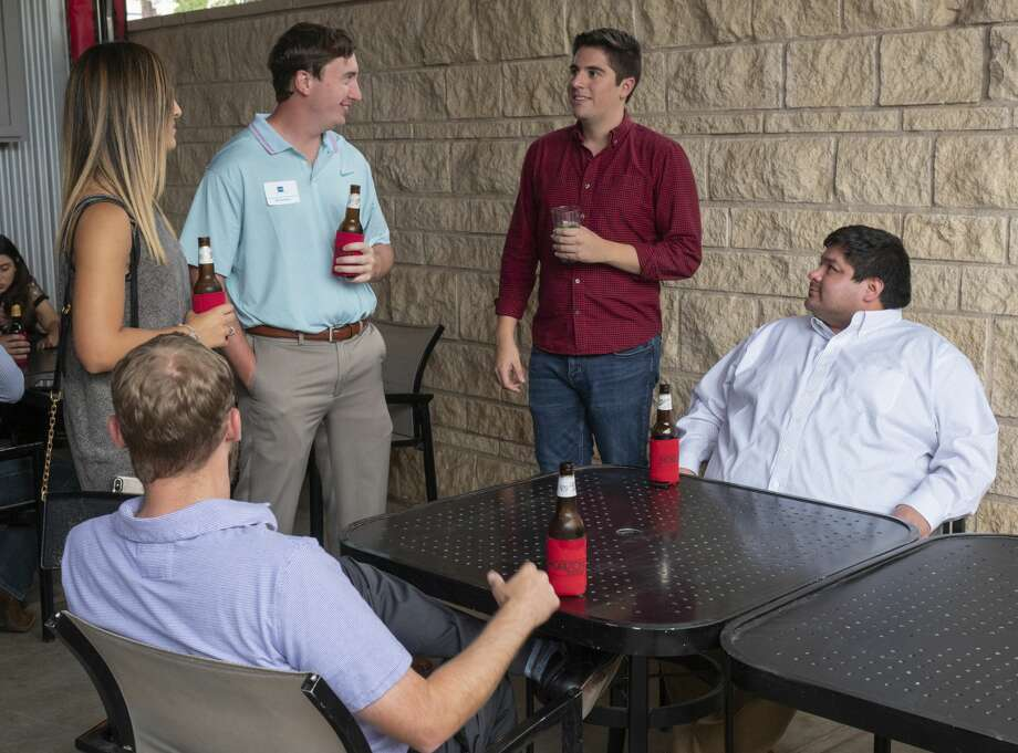 Midland young professionals gathered Aug. 21 at Basin Burger for a networking event. Photo: Tim Fischer/Midland Reporter-Telegram