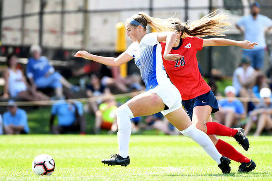 Saint Louis University's Annabelle Copeland, left, drives the ball against Dayton's Audrey Steiert Sunday at Hermann Stadium. A junior from Marquette Catholic High, Copeland scored a pair of goals to lead the Billikens to a 4-1 victory. Photo: SLU Athletics
