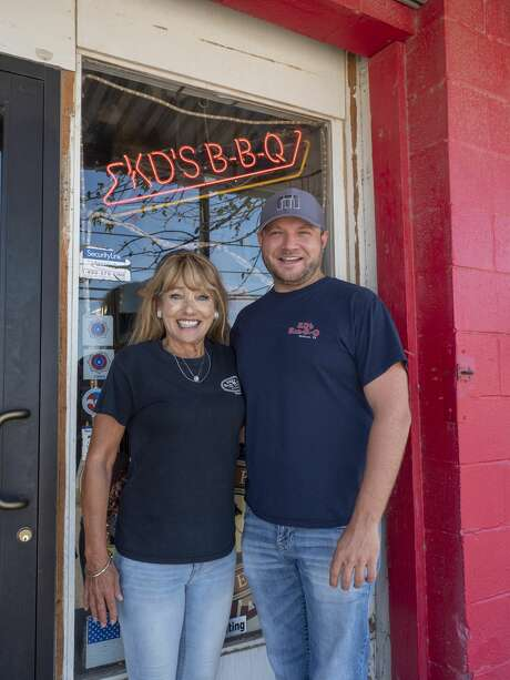KD's Bar-B-Q owned by Kathy Freeman, left, and her husband, Dwight Freeman. Their son, Dwight, right, is the restaurant's general manager. Photo: Tim Fischer/Midland Reporter-Telegram