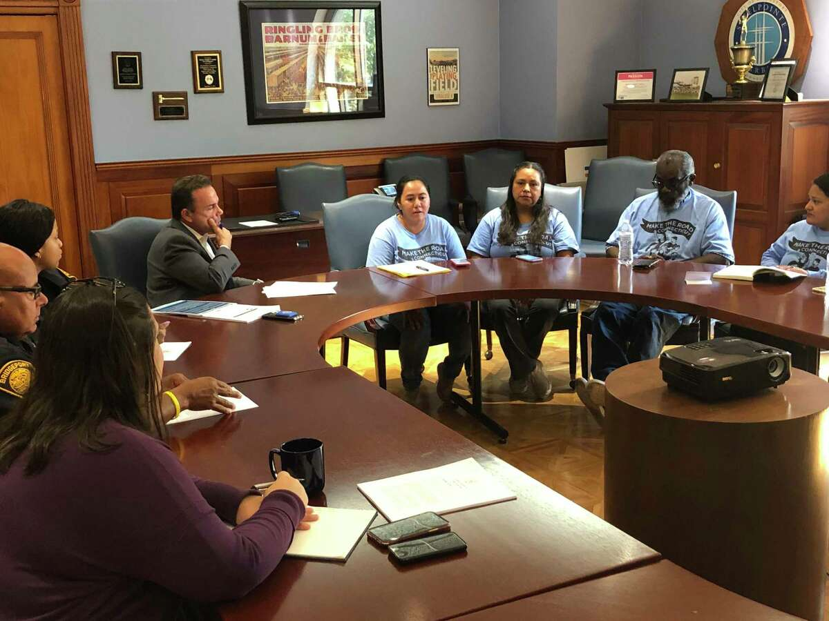 Bridgeport Mayor Joe Ganim listens to activists from Make the Road Connecticut during a meeting Sept. 30, 2019