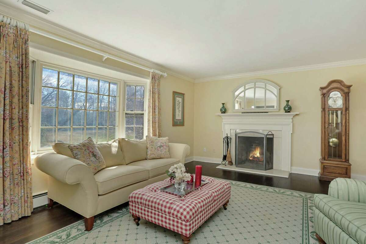 In the formal living room there is a wood-burning fireplace.