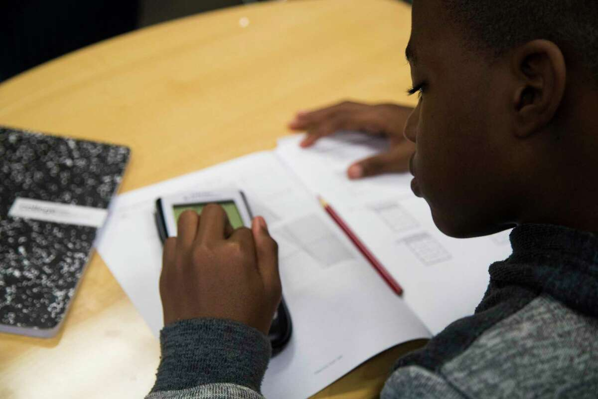 In this 2018 file photo, a freshman student at Houston ISD's Worthing High School completes school work at his Algebra I class. Worthing showed significant academic gains in 2018-19, but HISD did not meet most of its districtwide goals for the year.