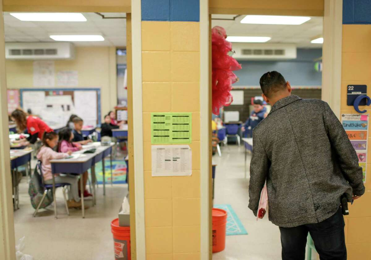 In this April file photo, a staff member at Houston ISD's Sanchez Elementary School checks in on students in the morning. Sanchez ranked among HISD's highest-performing schools in 2018-19, but the district did not meet most of its goals for the year.