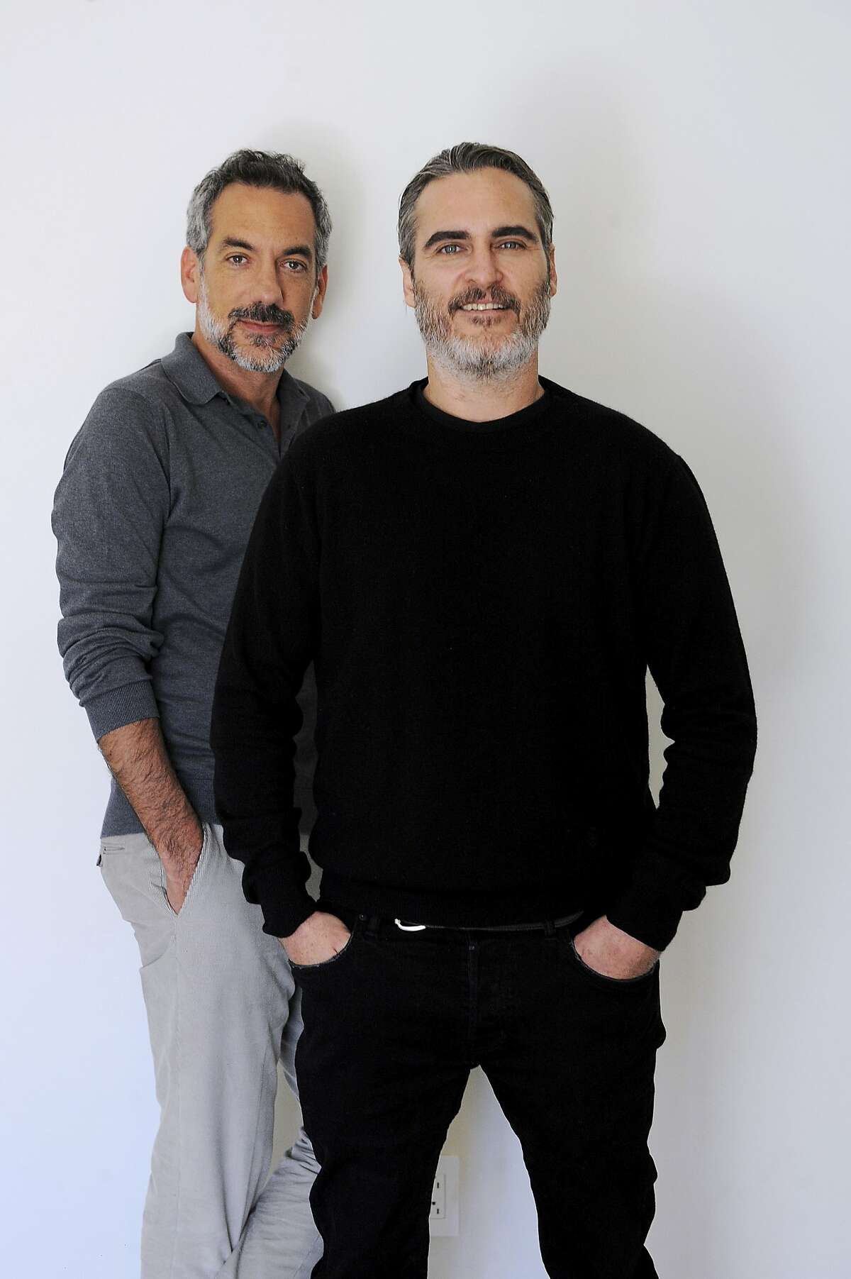 This Sept. 20, 2019 photo shows director Todd Phillips, left, and actor Joaquin Phoenix during a portrait session for the film