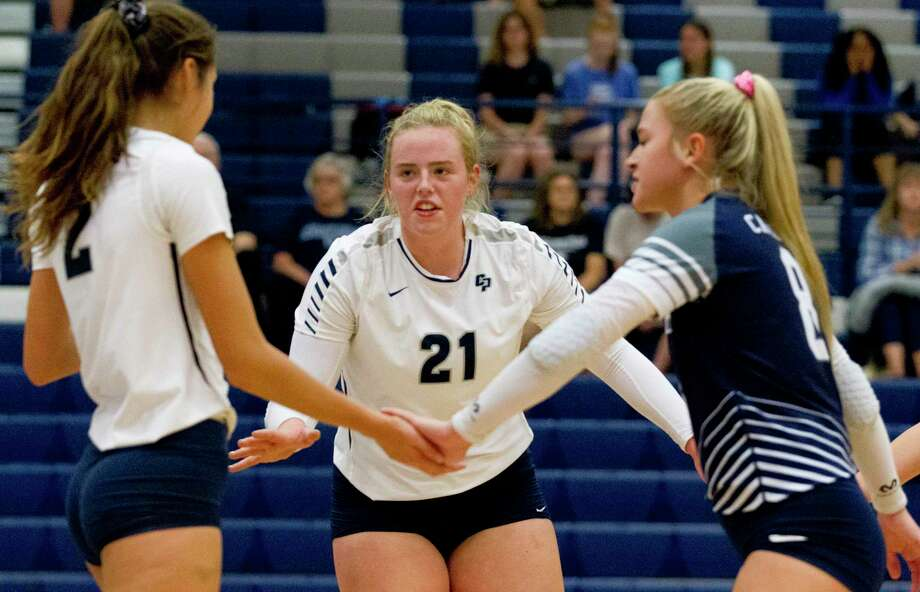 College Park setter Annie Cooke (21) encourages teammates in the first set of a match during the Kingwood Invitational volleyball tournament at Kingwood High School, Saturday, Aug. 17, 2019, in Kingwood. Photo: Jason Fochtman, Houston Chronicle / Staff Photographer / Houston Chronicle