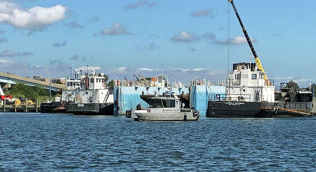 A boat from the Bridgeport Police Department Marine Unit returns to its dock Monday, Sept. 30, 2019 after assisting in the recovery of a body from the water.