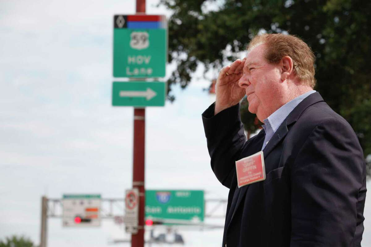 """Michael """"Griff"""" Griffin stands near signage near Louisiana and Franklin on Sept. 23, 2013 in Houston, to talk about his idea to open up HOV lanes at nights to help people get to and from downtown."""