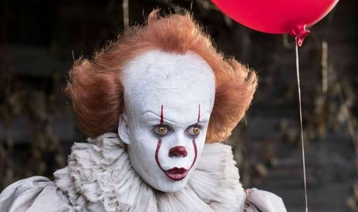 This image released by Warner Bros. Pictures shows Bill Skarsgard as the evil clown Pennywise in a scene from the film