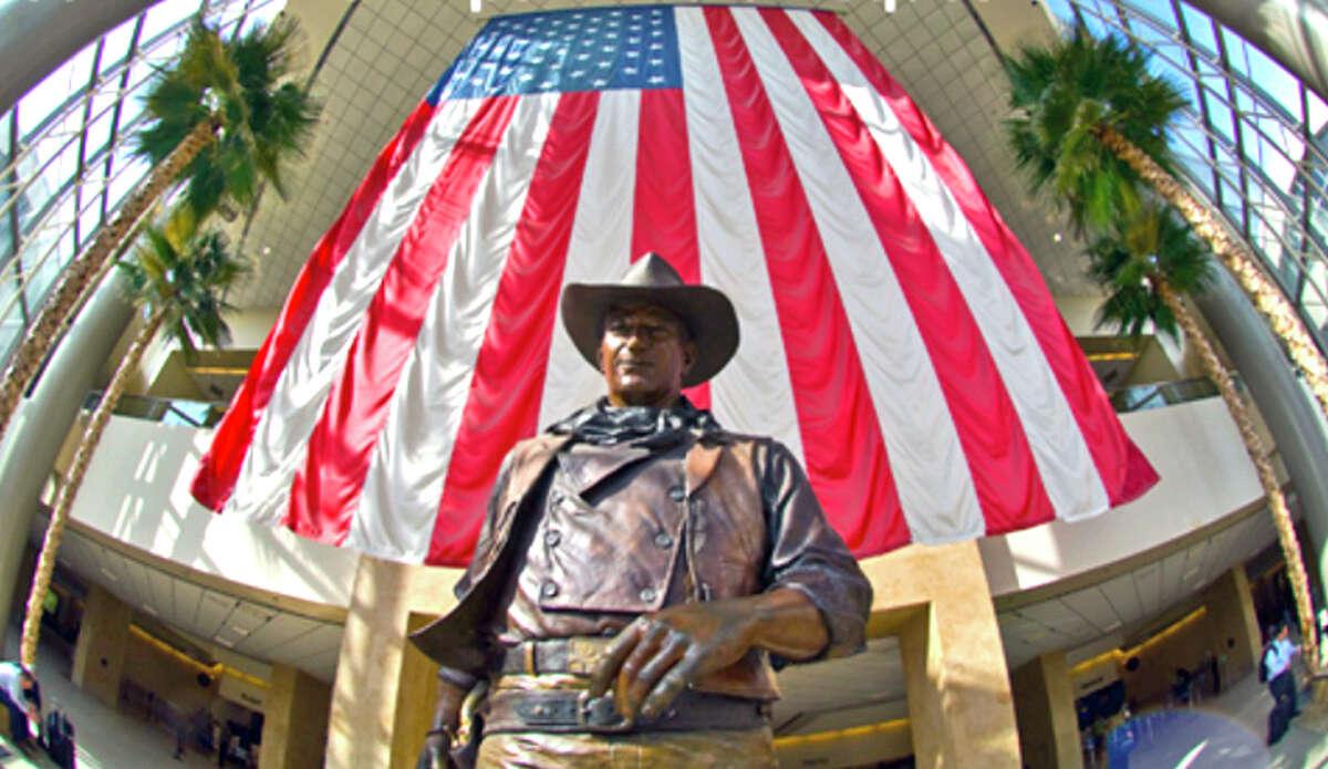 A local newspaper columnist wants John Wayne's name taken off Orange County's airport.