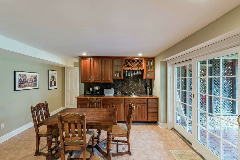 In the finished lower level there is a wet bar, ideal for entertaining. Photo: Charlie Pappas / 2017
