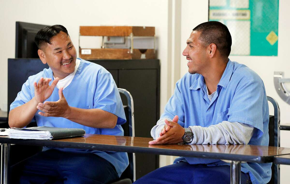 Group member Phang Thao, left, cheers Jonathan Rivas being voted into the group during the Kid CAT program for prisoners at San Quentin State Prison at San Quentin, Calif., on Thursday, July 18, 2019. The participants in the Kid CAT program were all juveniles tried and convicted as adults. The State of California is examining its juvenile offender policies.