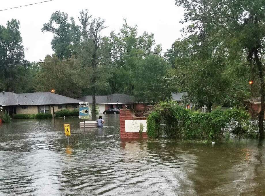 The entrance into Oak Forest hours after the rain had slowed down was underwater and residents were rescued by boats to get out. Photo: Karen Krnavek
