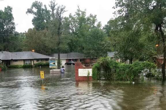 The entrance into Oak Forest hours after the rain had slowed down was underwater and residents were rescued by boats to get out.