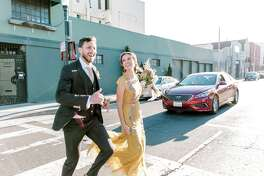 Newlyweds Zach and Sarah Rosenberg pose for photos in downtown San Francisco.