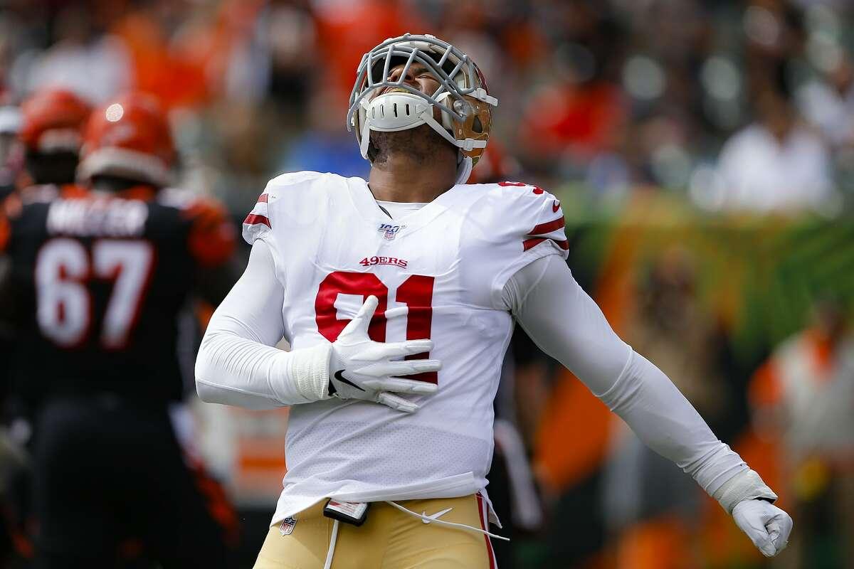 San Francisco 49ers defensive end Arik Armstead (91) reacts after sacking Cincinnati Bengals quarterback Andy Dalton during the first half an NFL football game, Sunday, Sept. 15, 2019, in Cincinnati. (AP Photo/Gary Landers)