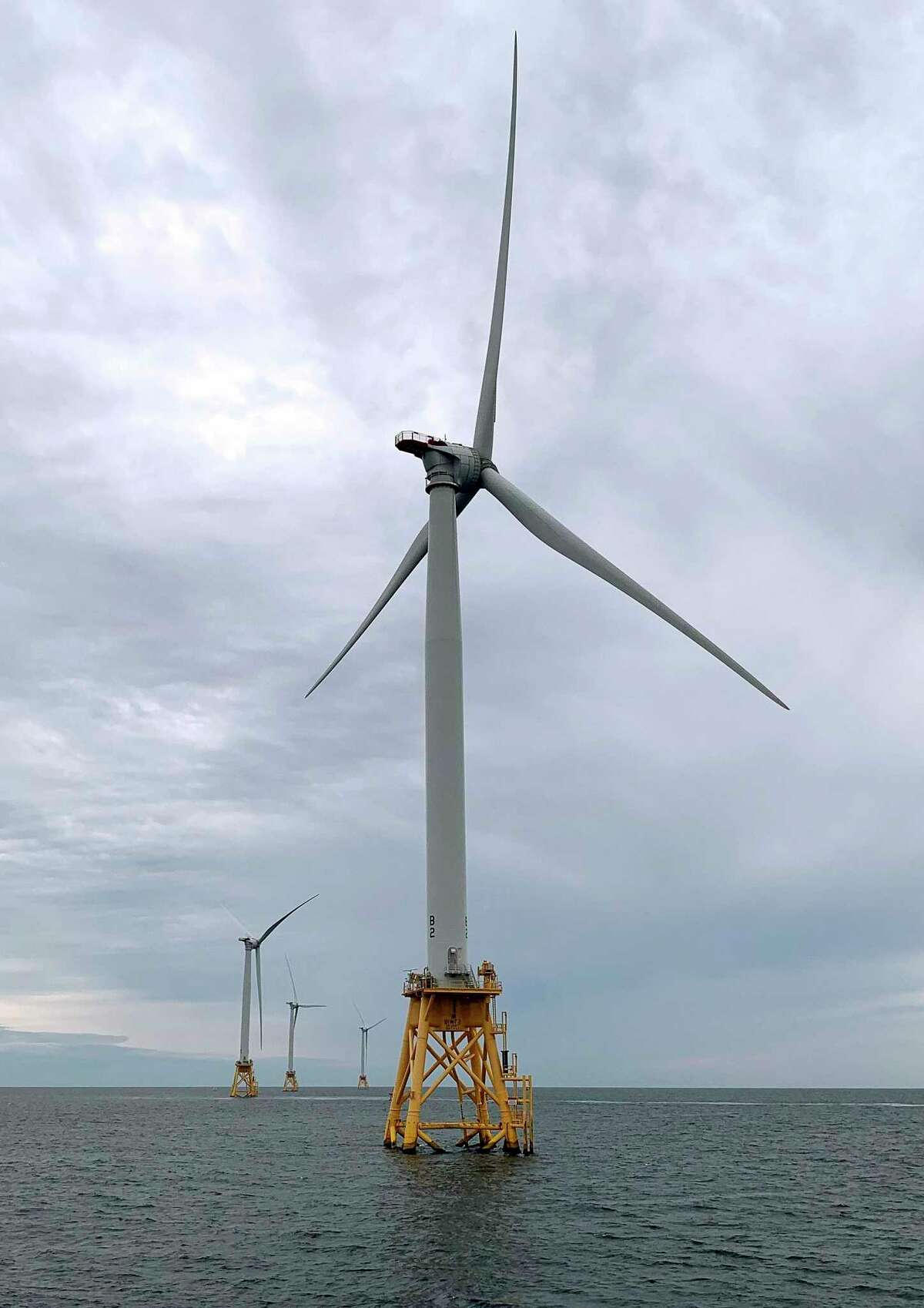 Wind turbines off Block Island, R.I. in August 2019. Exiting September, development groups filed plans for new wind farms off New England's southern coast to supply electricity to Connecticut. (AP Photo/Rodrique Ngowi)