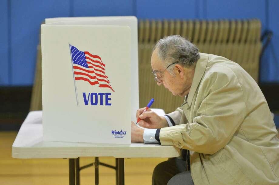 Former Norwalk Mayor Frank Zullo marks his ballot during election day voting at Tracey School on Tuesday November 7, 2017 in Norwalk Conn Photo: Alex Von Kleydorff / Hearst Connecticut Media / Norwalk Hour