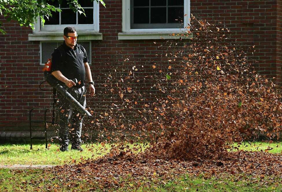 Maintenance supervisor Luis Martinez uses a blower to clear leaves from a sidewalk around The Gideon Putnam in Saratoga Spa State Park on Mon, Sept. 30, 2019 in Albany, N.Y. (Lori Van Buren/Times Union)