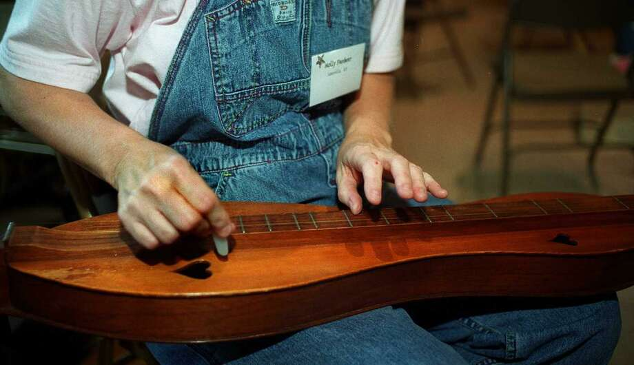 Molly Freibert of Louisville Ky.,plays a mountain dulcimer,at the Housatonic Dulcimer festival,at St. John's Episcopal church, Sept. 25 1999. Photo: File Photo / File Photo / The News-Times File Photo