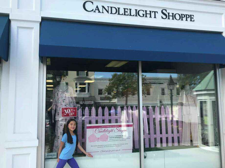 Ridgefield Girl Scout Ruby Weiner in front of the Candlelight Shoppe on Main Street. Photo: Contributed Photo