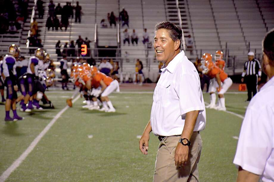 David Sanchez smiles — before getting a post-game dousing of water from his players — as United kneels down to finalize his 200th career victory. Photo: Cuate Santos / Laredo Morning Times / Laredo Morning Times