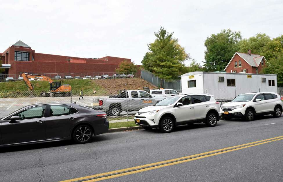 Construction on a parking garage near Lake and High Rock Avenues is underway on Monday, Sept. 30, 2019 in Saratoga Springs, N.Y. The Saratoga Springs City Center is seen on the left and The Mouzon House is seen on the right. (Lori Van Buren/Times Union)