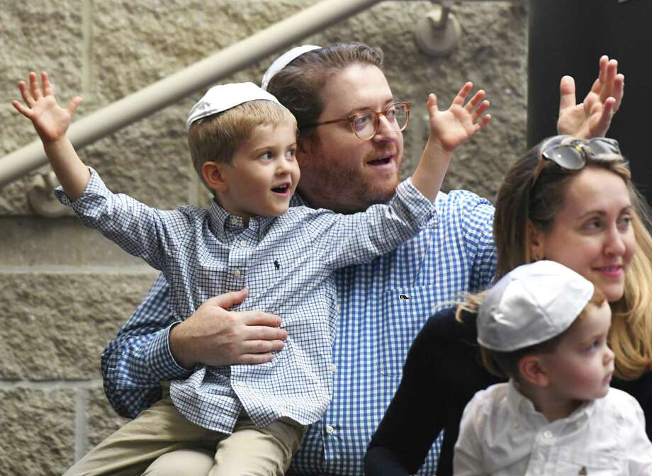 Greenwich's Joe Rothenberg sings songs with his son Max, 5, wife Marin, and son Henry, 2, during the Tot Rosh Hashanah service at Temple Sholom in Greenwich Monday. The program led by musical guest Sheldon Low and Rabbi Chaya Bender featured many fun singalongs for young children and their parents to celebrate the Jewish New Year. Photo: Tyler Sizemore / Hearst Connecticut Media / Greenwich Time