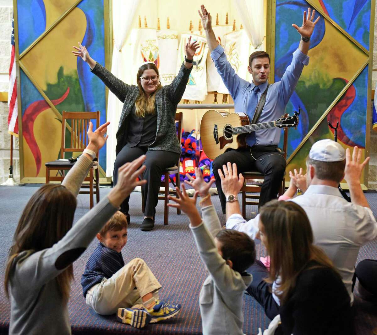 Rabbi Chaya Bender and musician Sheldon Low lead the Tot Rosh Hashanah service at Temple Sholom in Greenwich, Conn. Monday, Sept. 30, 2019. The program featured many fun singalongs for young children and their parents to celebrate the Jewish New Year.