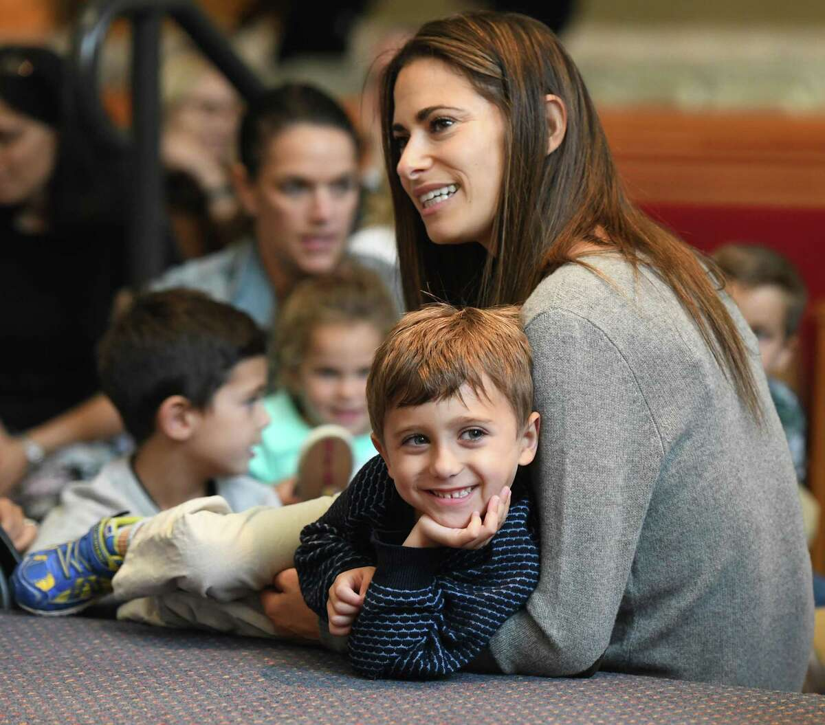 Greenwich's Allie Speiser and her son Leo, 4, listen to music during the Tot Rosh Hashanah service at Temple Sholom in Greenwich, Conn. Monday, Sept. 30, 2019. The program led by musical guest Sheldon Low and Rabbi Chaya Bender featured many fun singalongs for young children and their parents to celebrate the Jewish New Year.