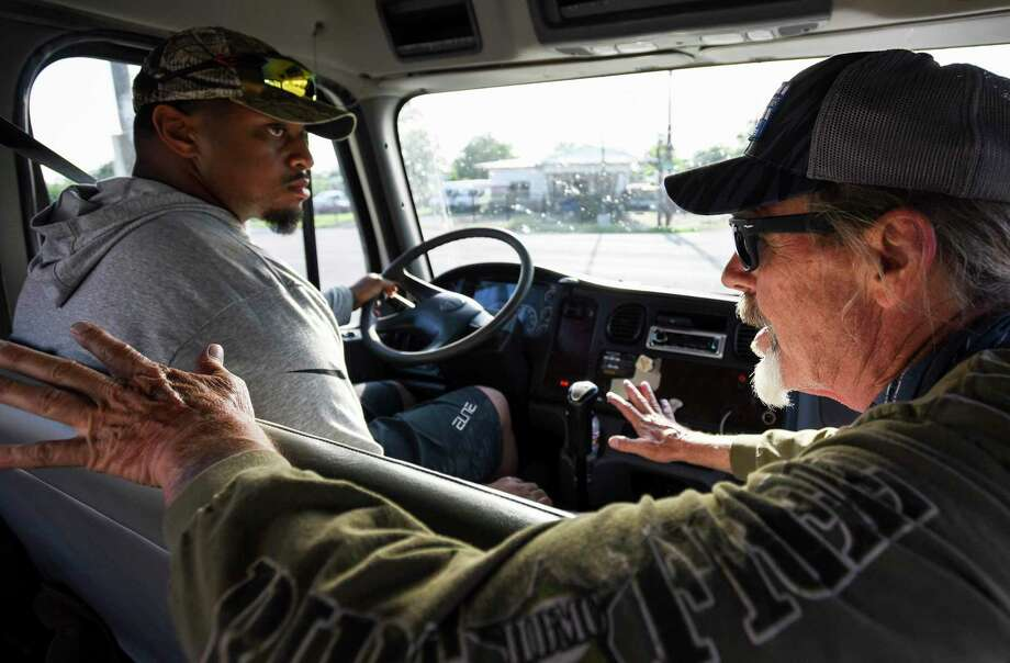 A truck driving student gets some instruction before handling a big rig. A reader says it would be great if guns were regulated by vehicles. That would mean people would have licenses and gun manufacturers would be regulated. Photo: Ryan Welch /The Enterprise / © 2019 Beaumont Enterprise