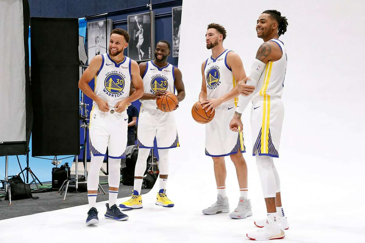 Golden State Warriors' Stephen Curry, Draymond Green, Klay Thompson and D'Angelo Russell during media day at Chase Center in San Francisco, Calif., on Monday, September 30, 2019.