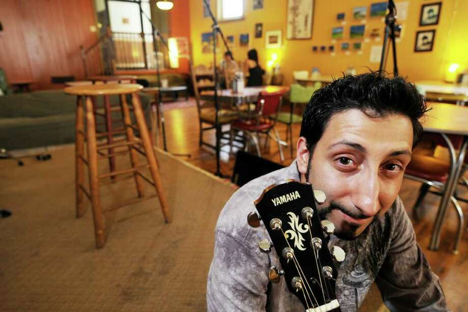 Sal Prizio, owner of Bread and Jam Cafe on Remsen St. on Monday, August 2, 2010, in Cohoes, NY.   This is Sal with his guitar, used for among other things, to play when he hosts the cafe's open mic nights on Thursdays.   (Luanne M. Ferris/Times Union) Photo: LUANNE M. FERRIS