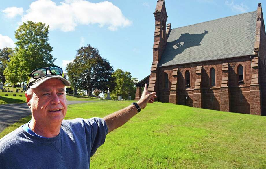 Indian Hill Cemetery in Middletown will be holding an event Saturday during which the chapel's restored 1870 Meneely Bell will be rung for the first time in approximately 75 years. These bells, among 65,000 made in Troy, New York, were cast between 1826 and 1952. Here, cemetery superintendent Norm Emond explains how the bell is run via an electrical system. Photo: Cassandra Day / Hearst Connecticut Media