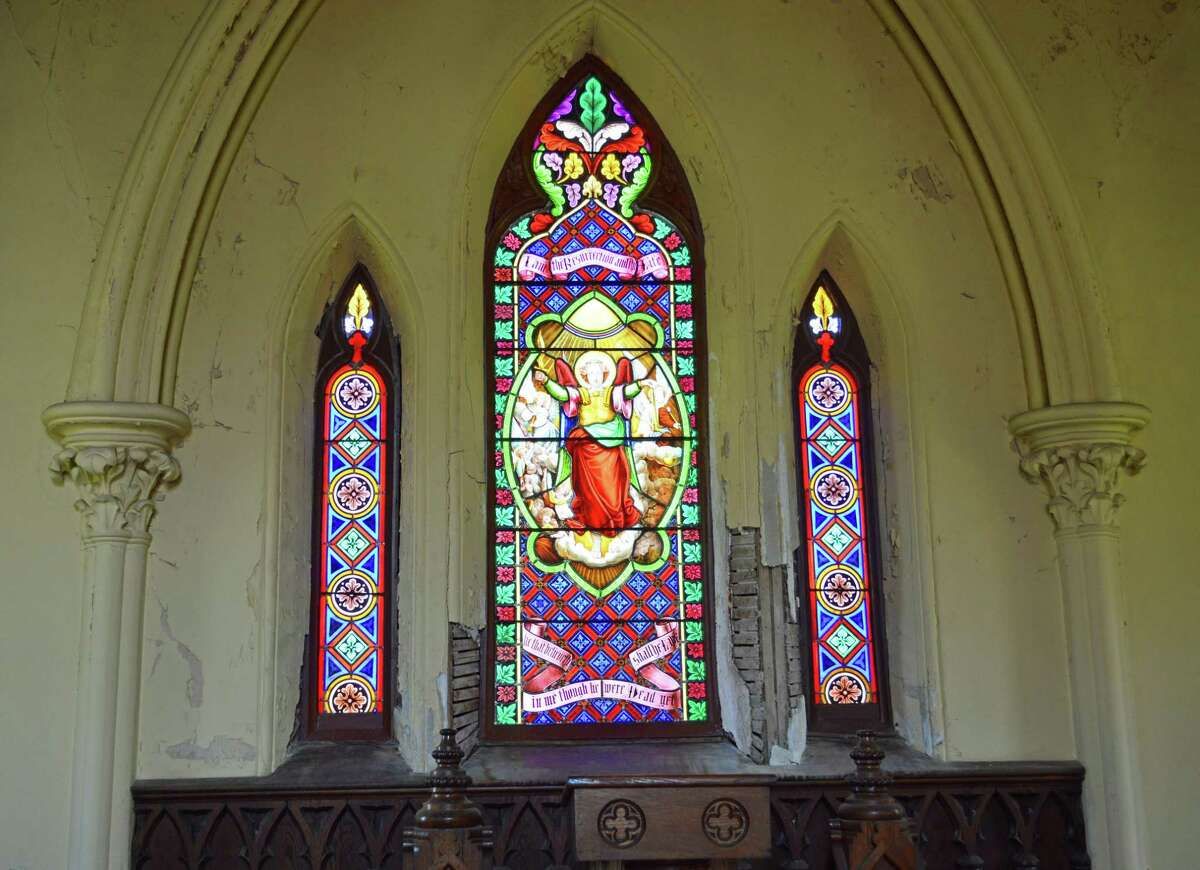 The interior of the chapel at Indian Hill Cemetery in Middletown has original stained glass window panels.