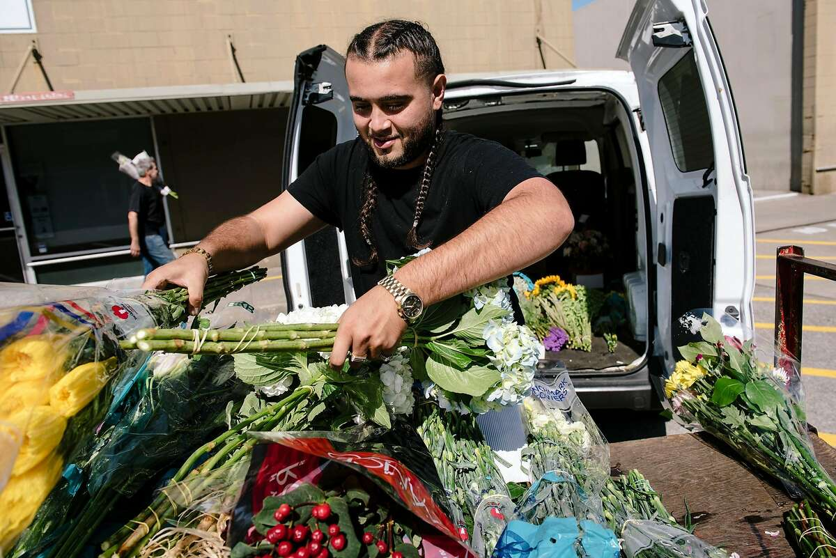 Maurice Sharif of East Bay Flowers in San Leandro loads up a van with flowers at the San Francisco Flower Mart in San Francisco, Calif, on Monday, September 30, 2019.