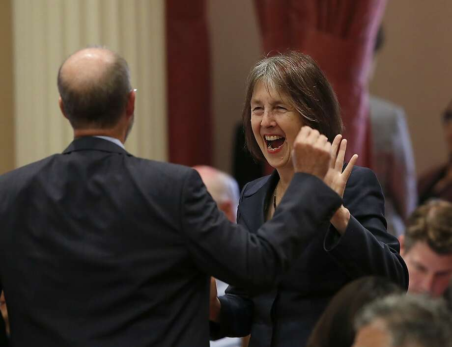 State Sen. Nancy Skinner, D-Berkeley, celebrating Senate approval lsat month of her measure to let college athletes earn endorsement money. Photo: Rich Pedroncelli / Associated Press