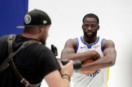 Draymond Green (23) has his portrait made by Warriors team photographer Noah Graham during media day for the Golden State Warriors at Chase Arena in San Francisco, Calif., on Monday, September 30, 2019.